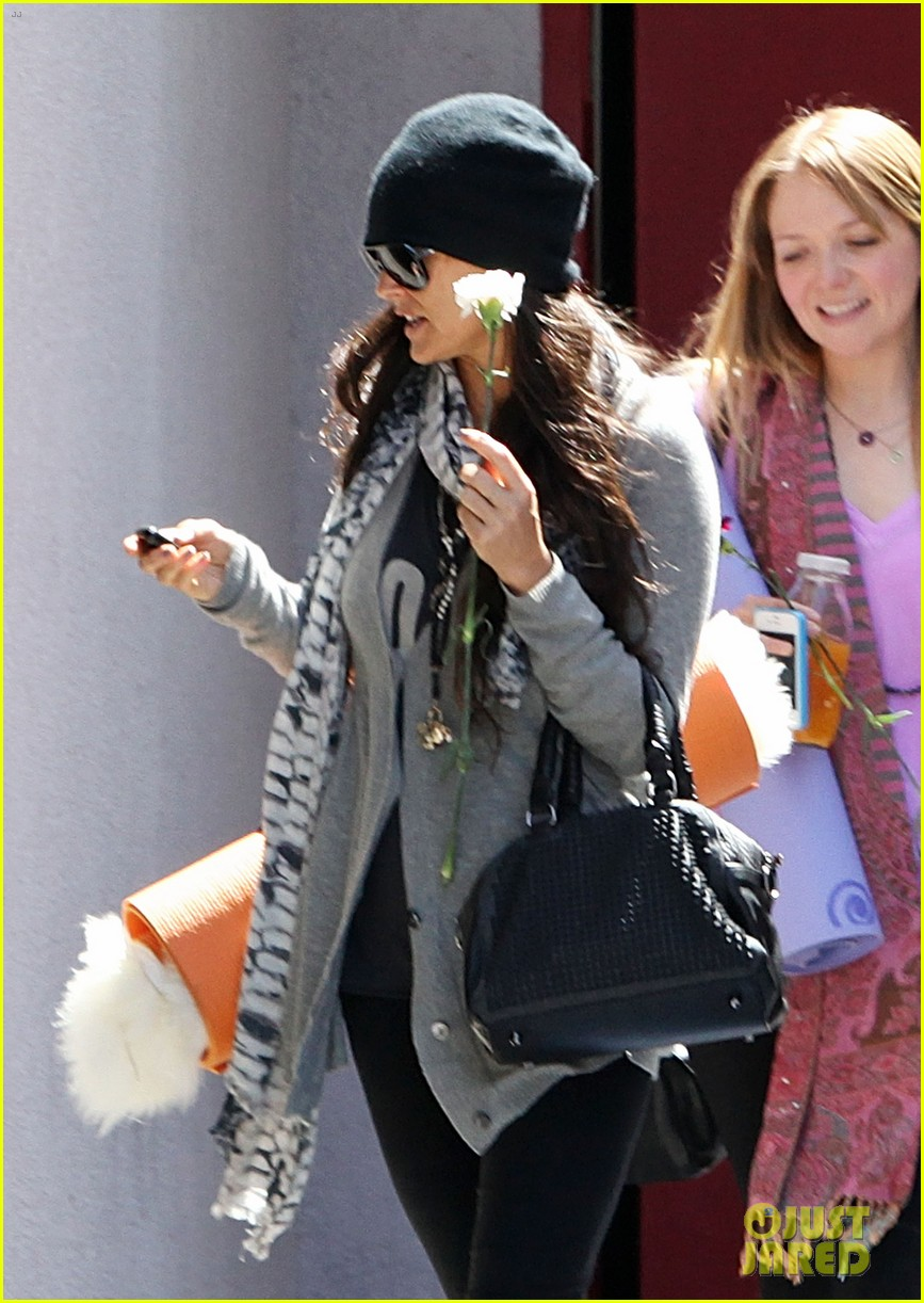 demi lovato carries a white rose out of yoga class 10