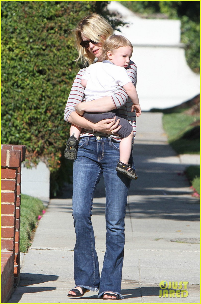 january jones xander walks in front of mommy 032869197