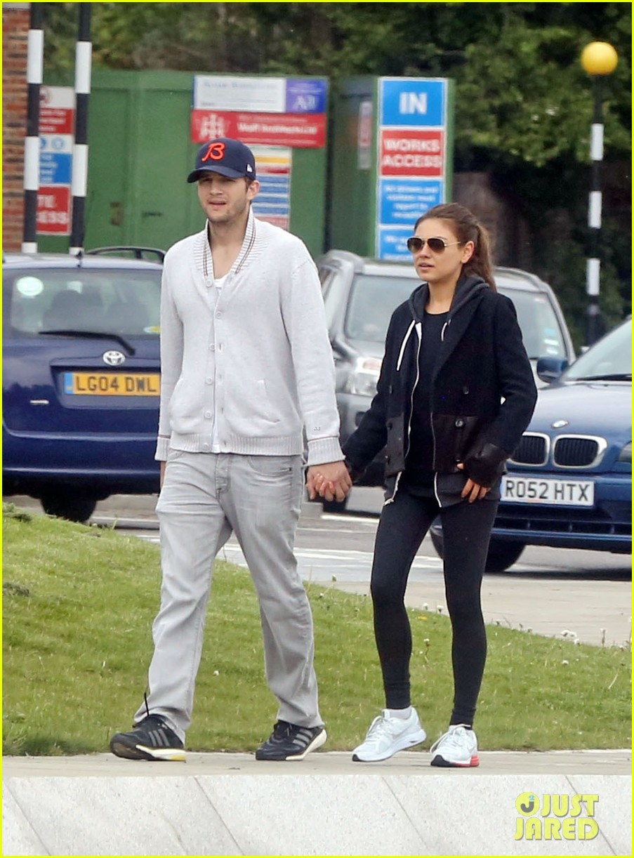 mila kunis ashton kutcher hold hands on london stroll 012873619