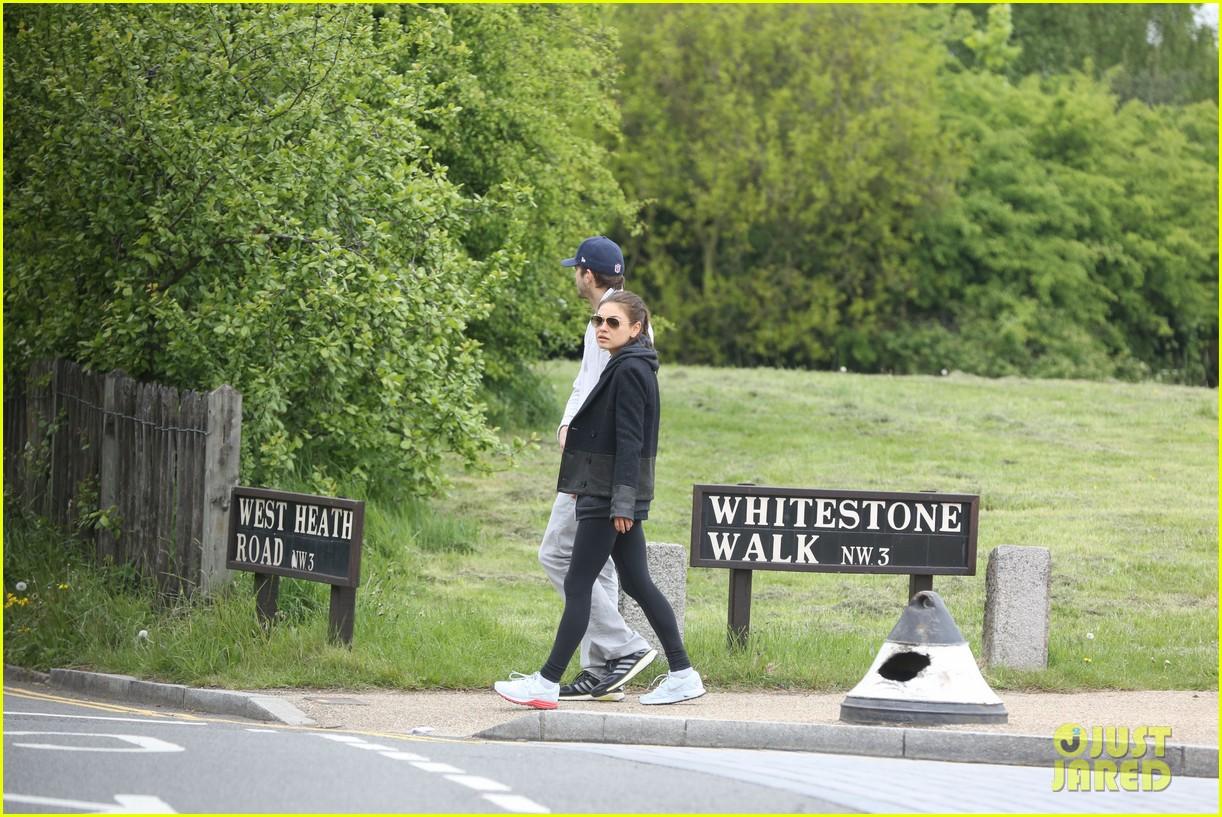 mila kunis ashton kutcher hold hands on london stroll 05