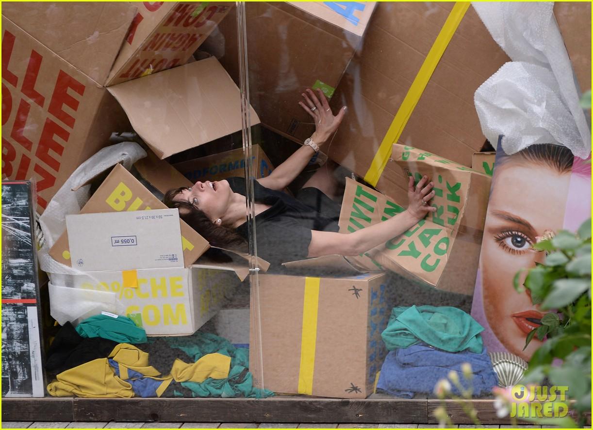 milla jovovich performs in plexiglass for international art exhibition 22