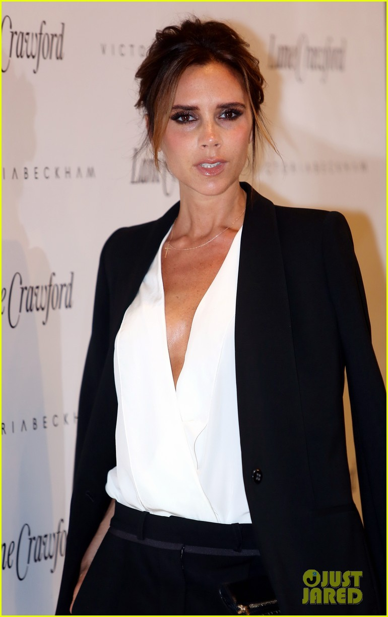 victoria beckham promotes fashion line david beckham greets at hm 042898774