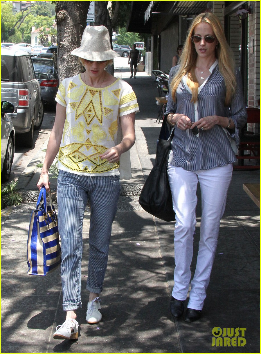 january jones hides new haircut under hat 132891383