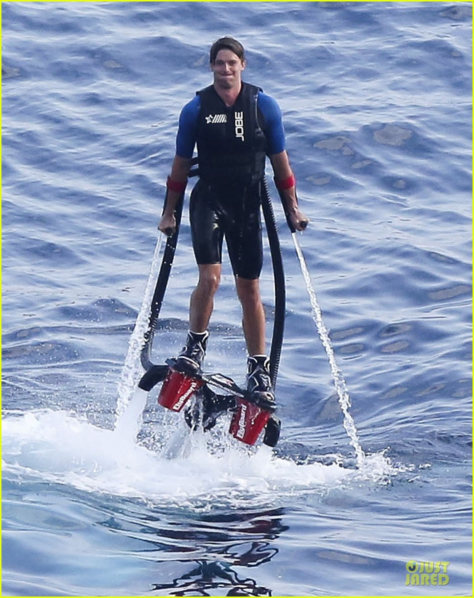 patrick schwarzenegger goes shirtless during jet pack fun 072891888