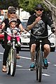 pink carey hart bike riding with willow 16