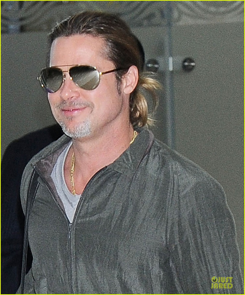 brad pitt pax south korea arriving father son duo 042888673