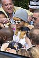 rihanna swarmed by fans at antwerp hotel 02