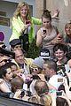 rihanna swarmed by fans at antwerp hotel 06