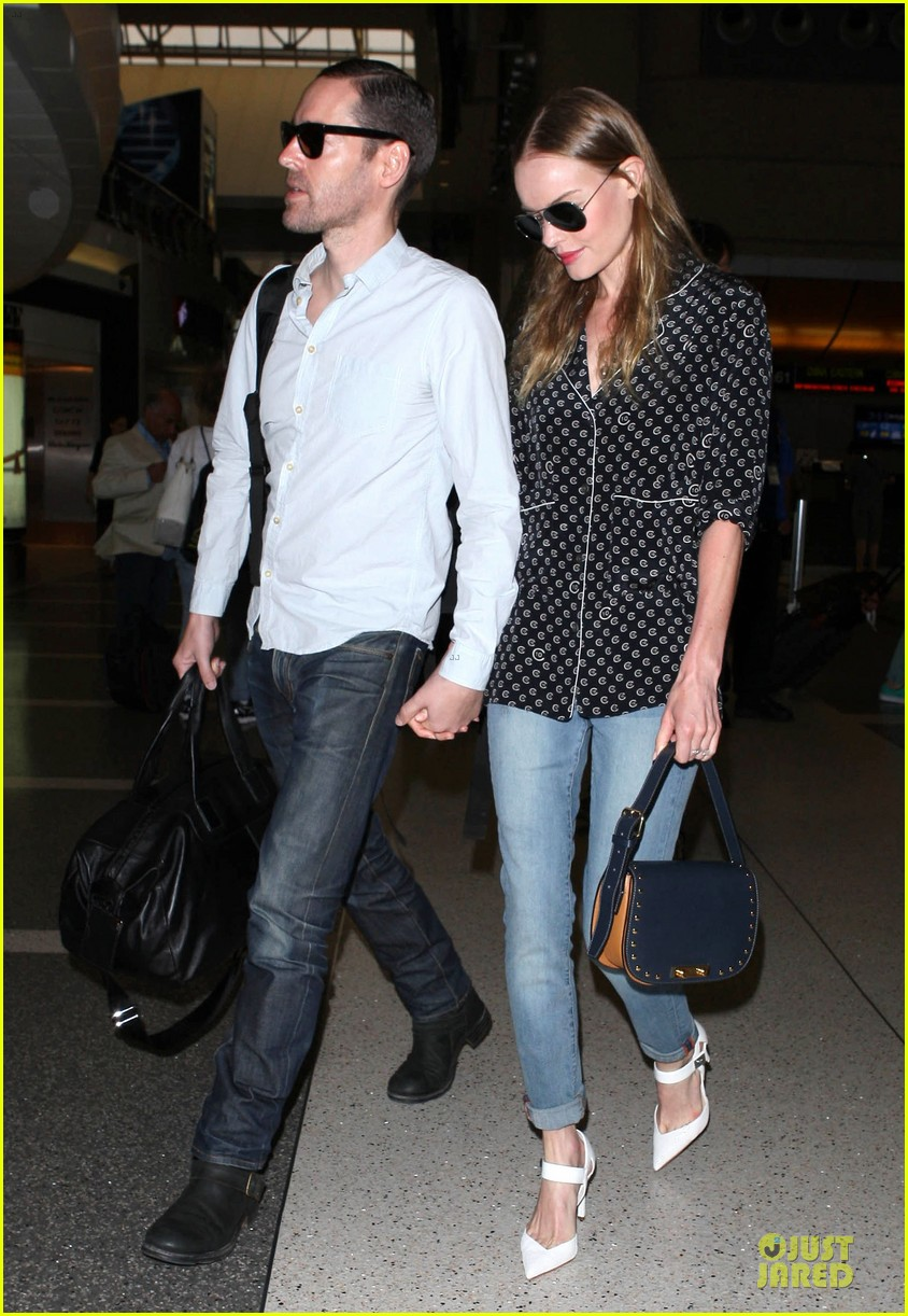 kate bosworth michael polish hold hands for south korea flight 202902142