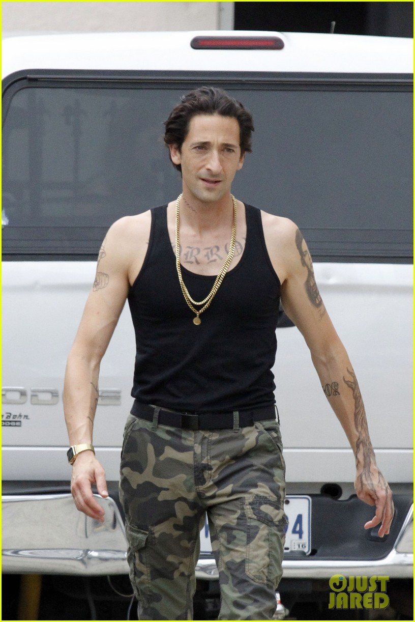 adrien brody sports fake tattoos for american heist 02