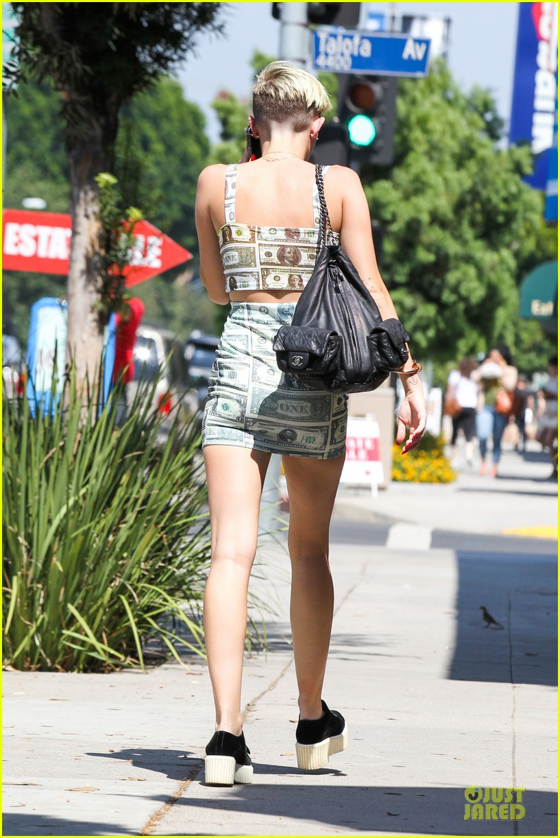 miley cyrus bares midriff with money dress 11