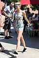 miley cyrus bares midriff with money dress 06