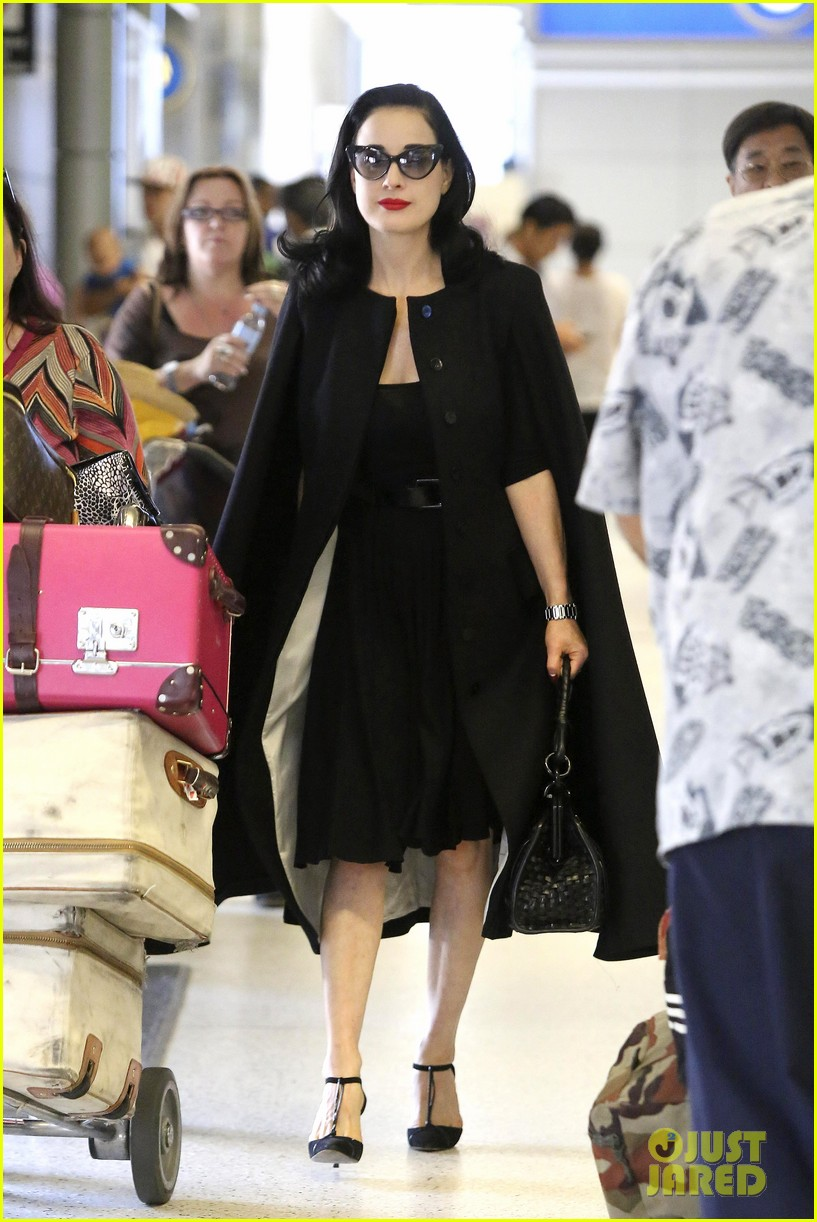 dita von teese wears cape for flight to buenos aires 06