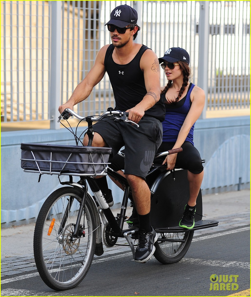 taylor lautner bike ride with marie avgeropoulos 03