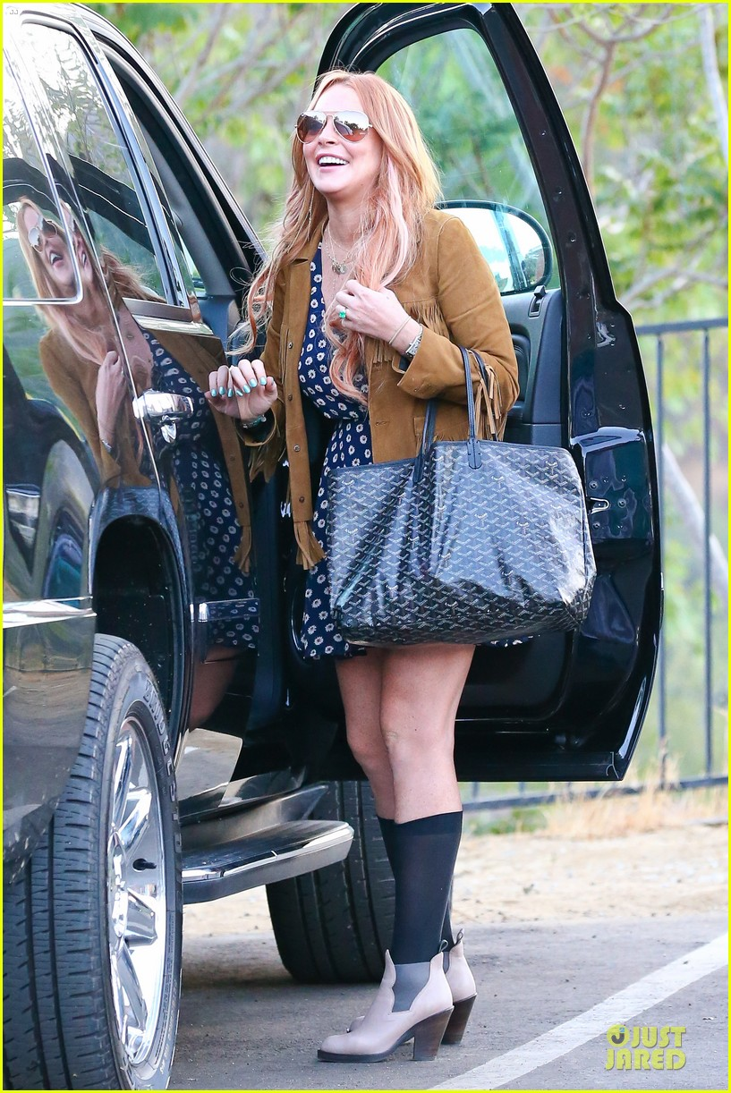 lindsay lohan released from rehab smiles while leaving 16