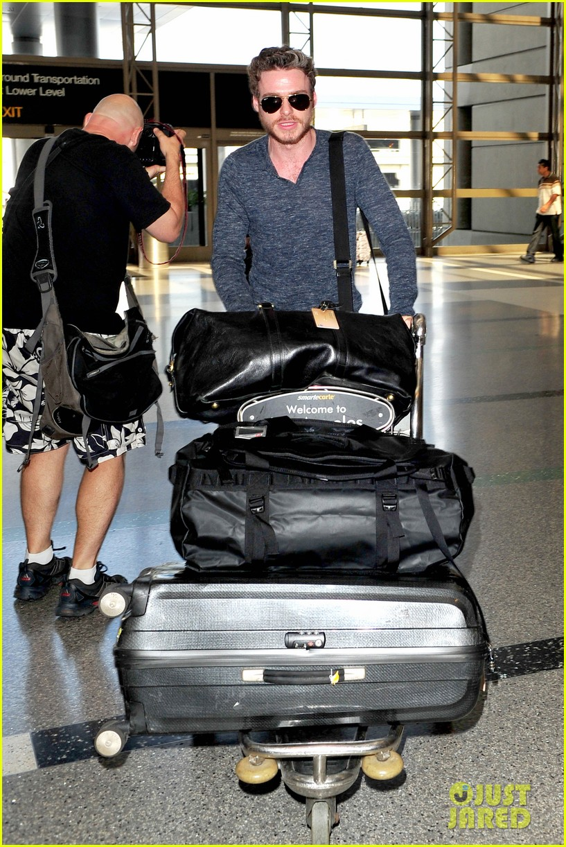 richard madden jenna coleman lots of luggage at lax 172917834