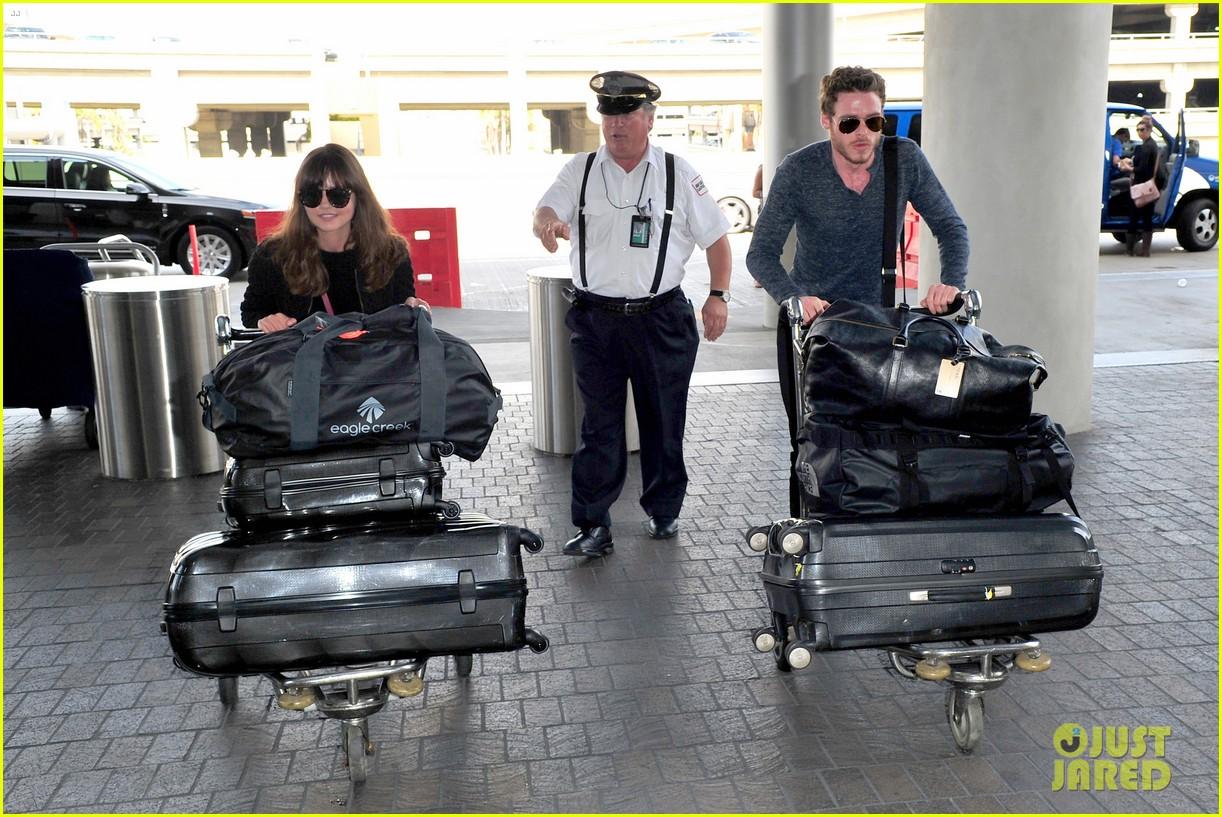 richard madden jenna coleman lots of luggage at lax 24