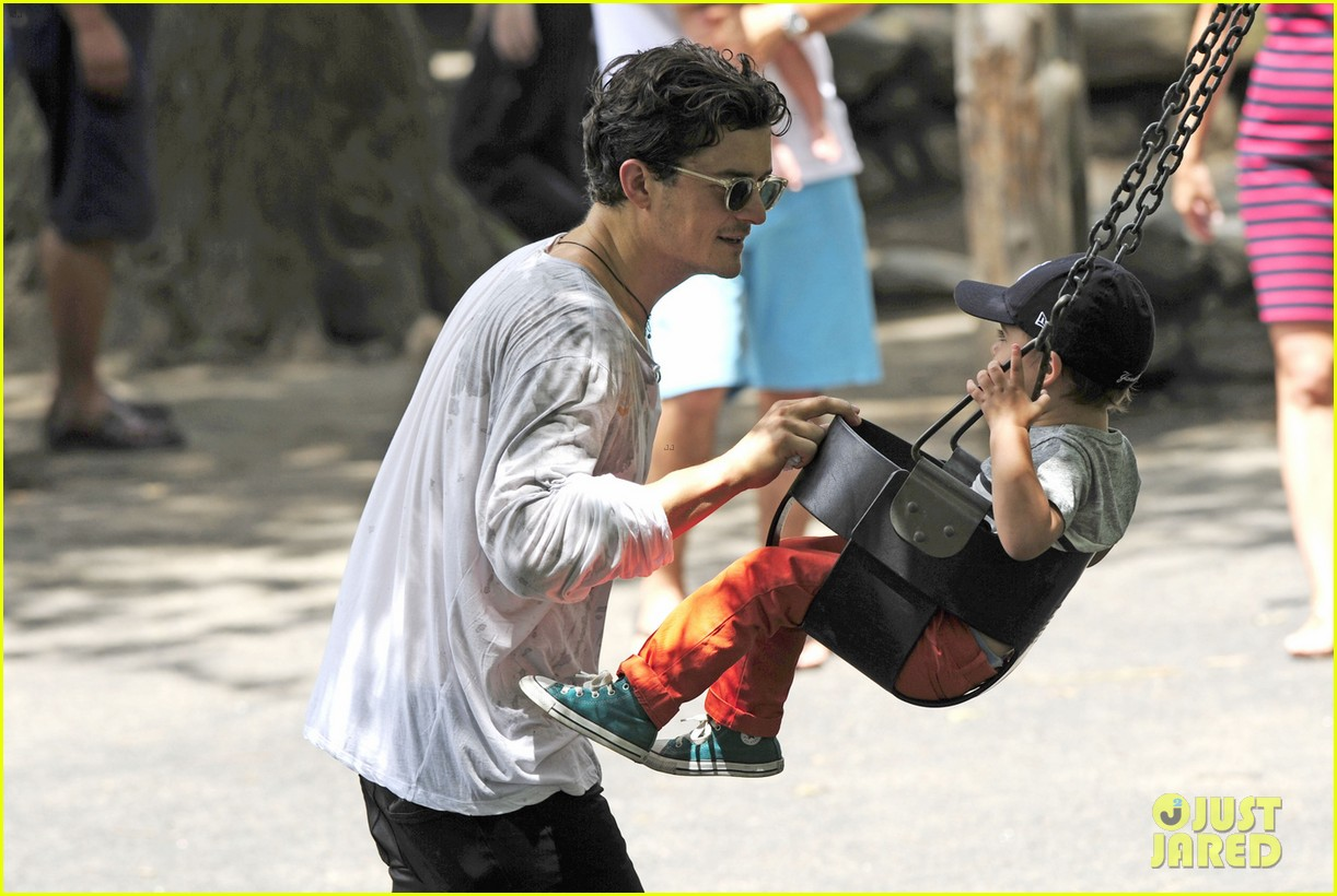 orlando bloom takes flynn to central park miranda kerr hits jfk 092909394