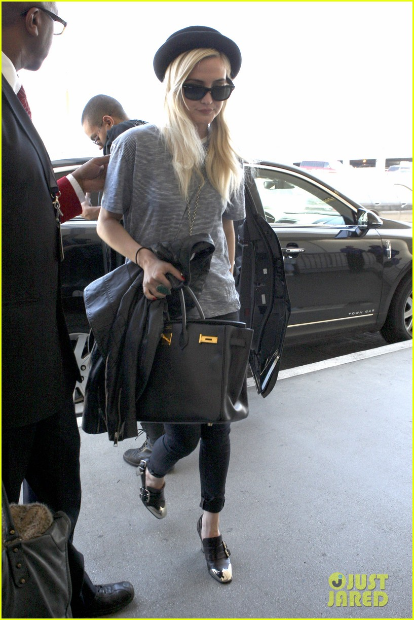 ashlee simpson evan ross travel together out of lax 09