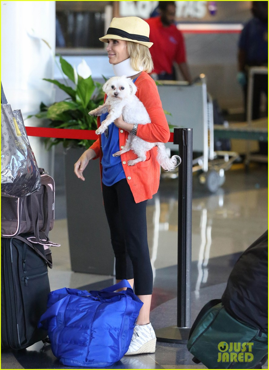 kristin chenoweth wears neck brace for flight to miami 022927210