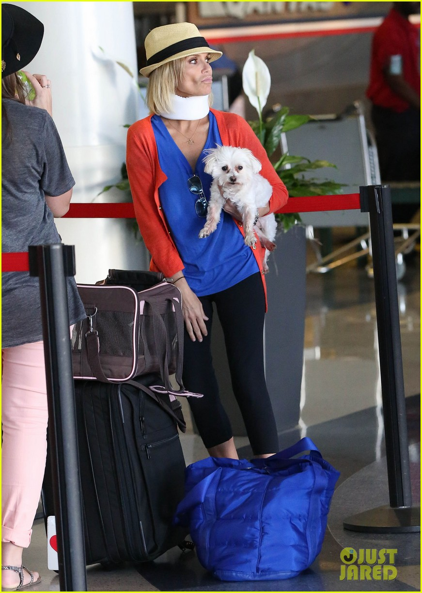 kristin chenoweth wears neck brace for flight to miami 08