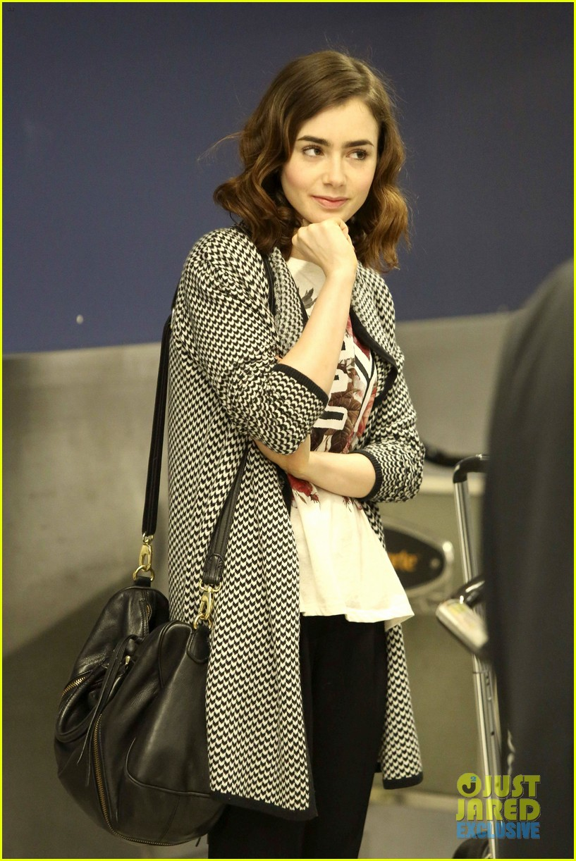 lily collins pushes giant luggage cart after mortals tour 07