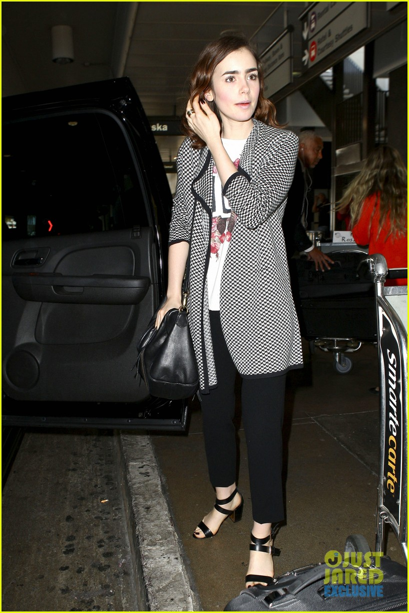 lily collins pushes giant luggage cart after mortals tour 24