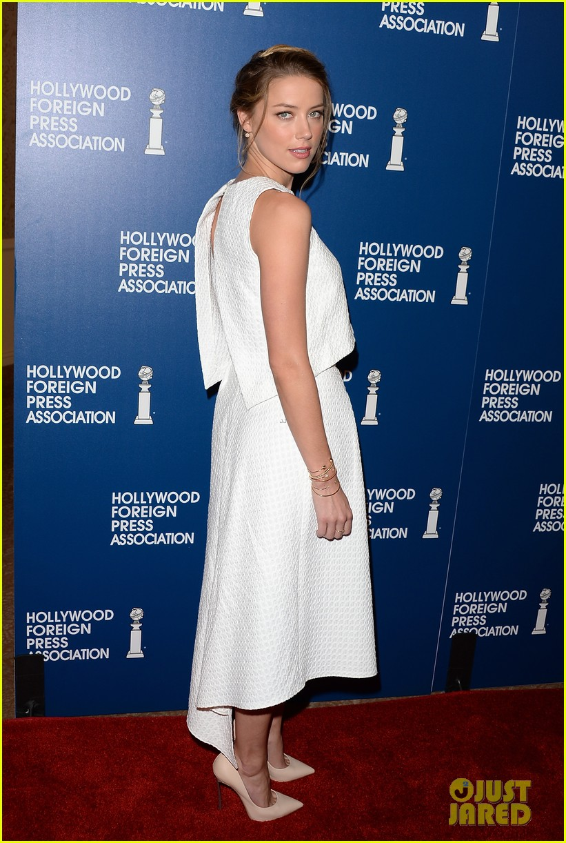 amber heard liam hemsworth hfpa installation luncheon 2013 112929519