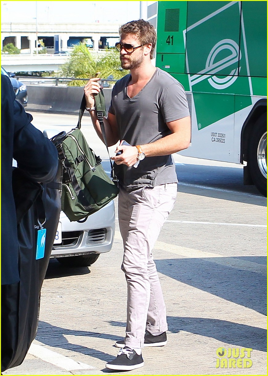 liam hemsworth takes flight miley cyrus sports tiny hair buns 012941099