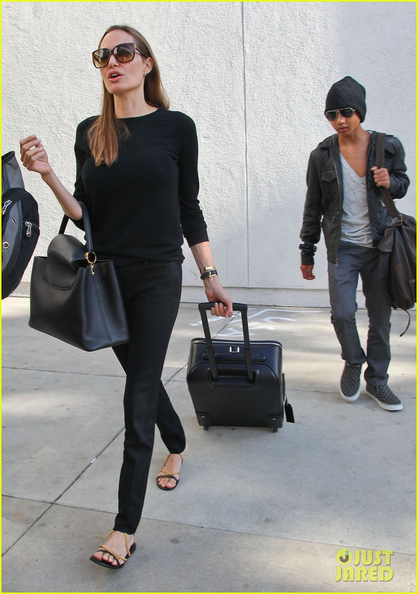 angelina jolie lands in los angeles with maddox 05