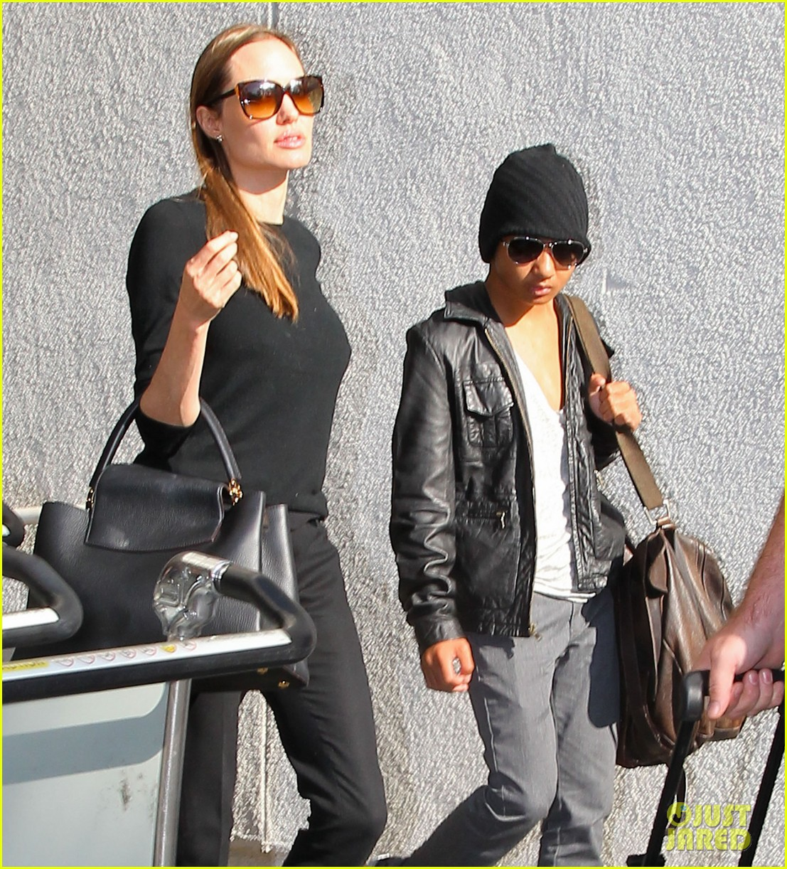angelina jolie lands in los angeles with maddox 06