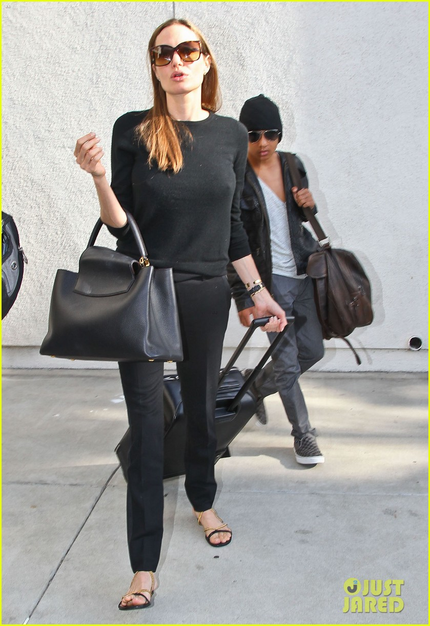 angelina jolie lands in los angeles with maddox 07
