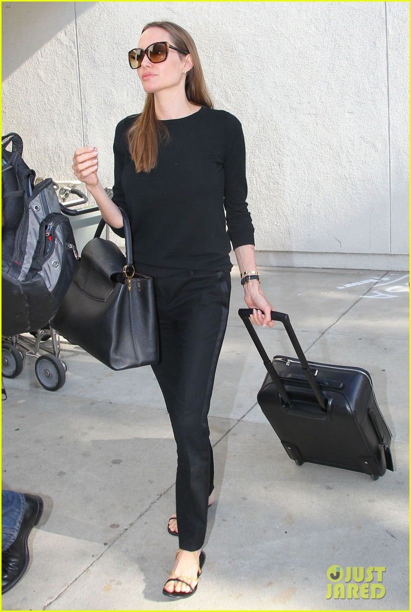 angelina jolie lands in los angeles with maddox 10