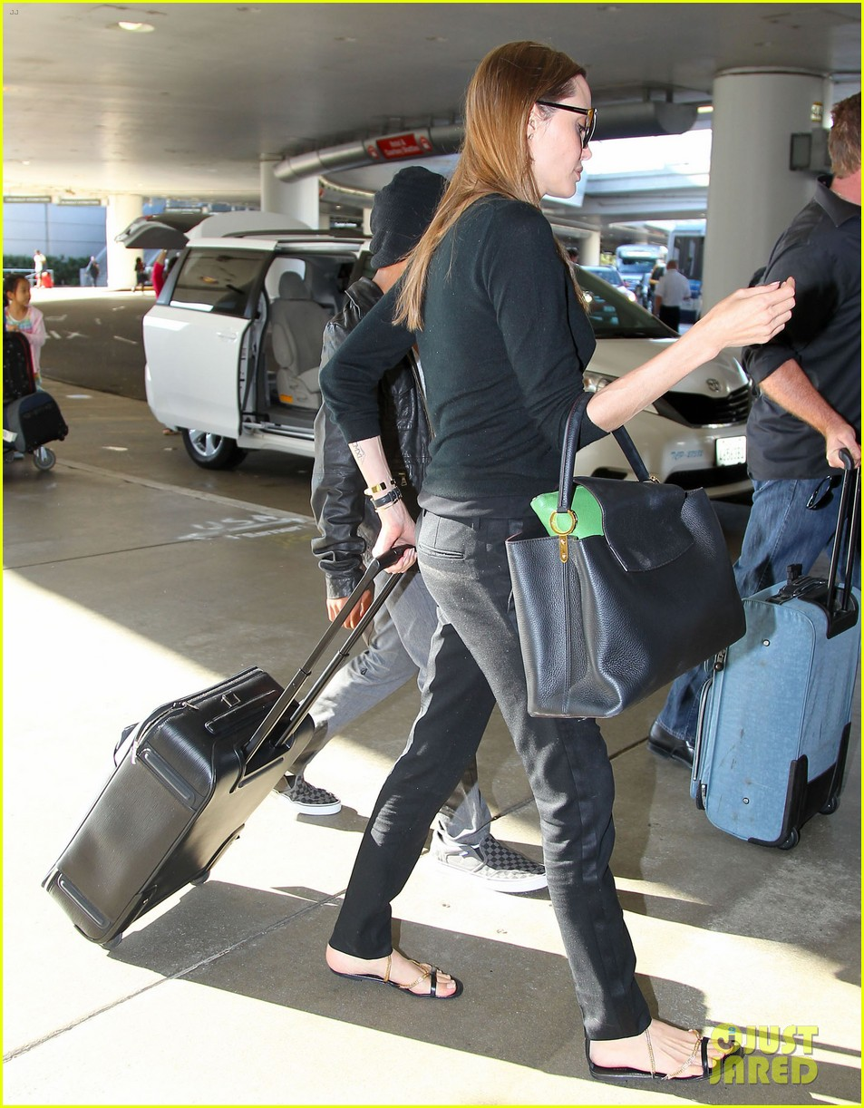 angelina jolie lands in los angeles with maddox 19