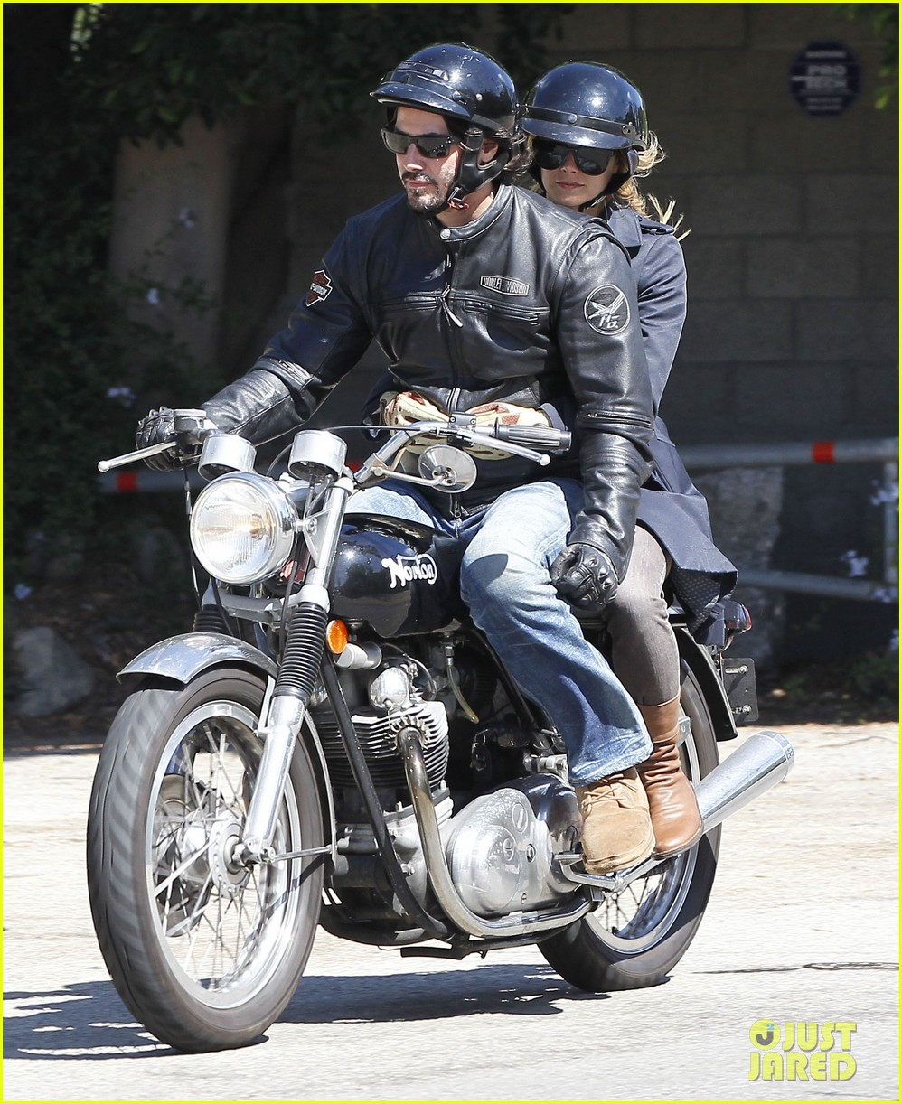 keanu reeves motorcycle ride with mystery blonde 032923308