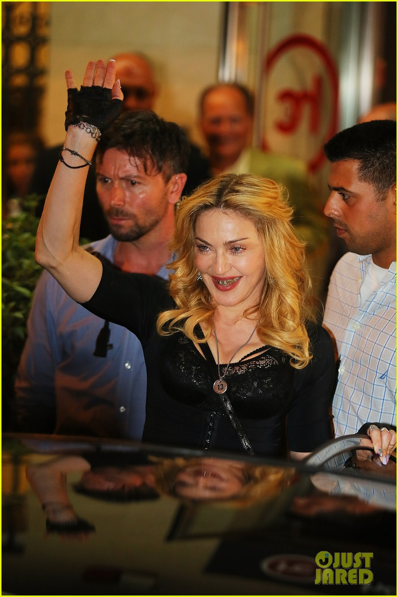 madonna rocks gold grills at the hard candy fitness center 022935295