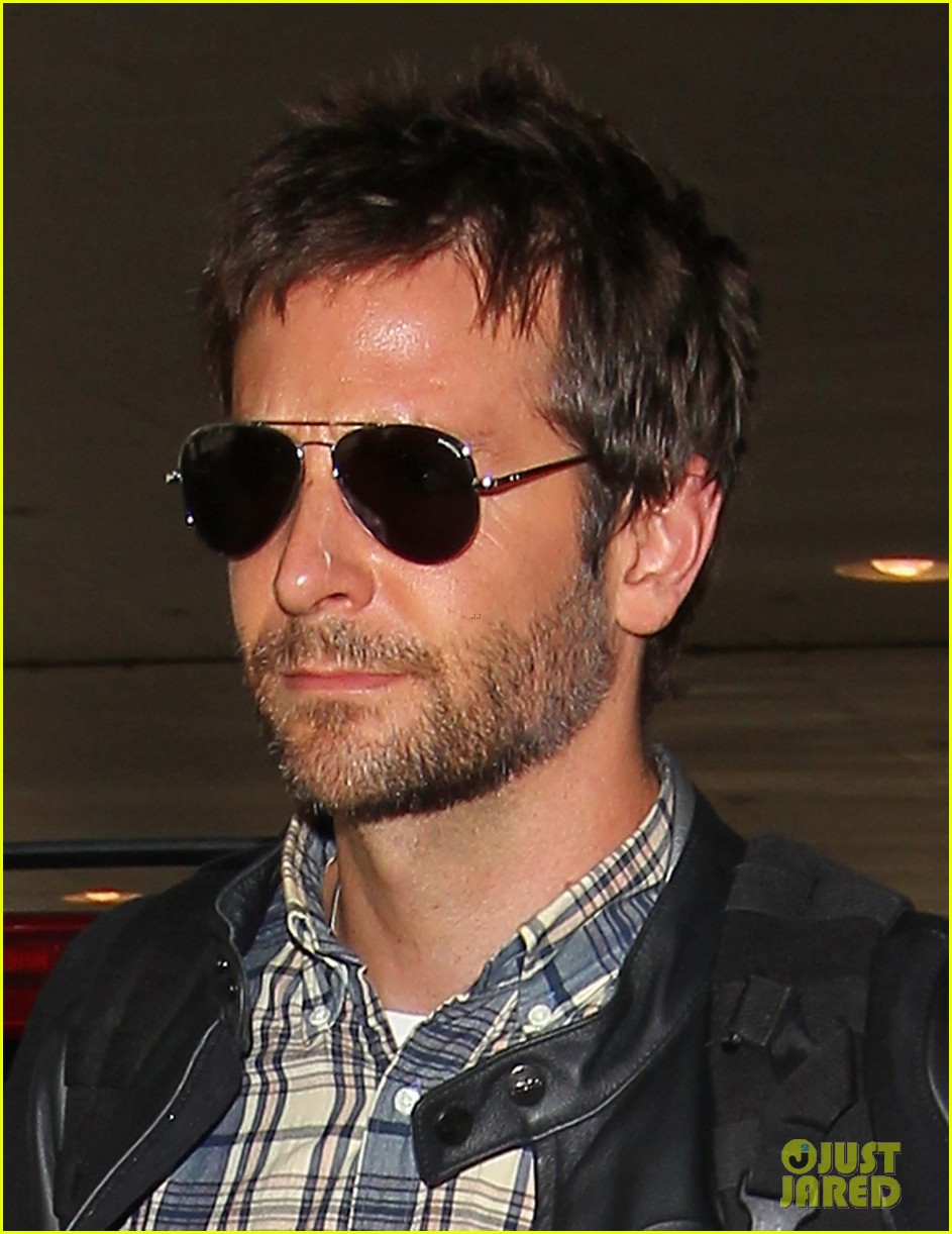 bradley cooper lands back home after press tour in spain 03