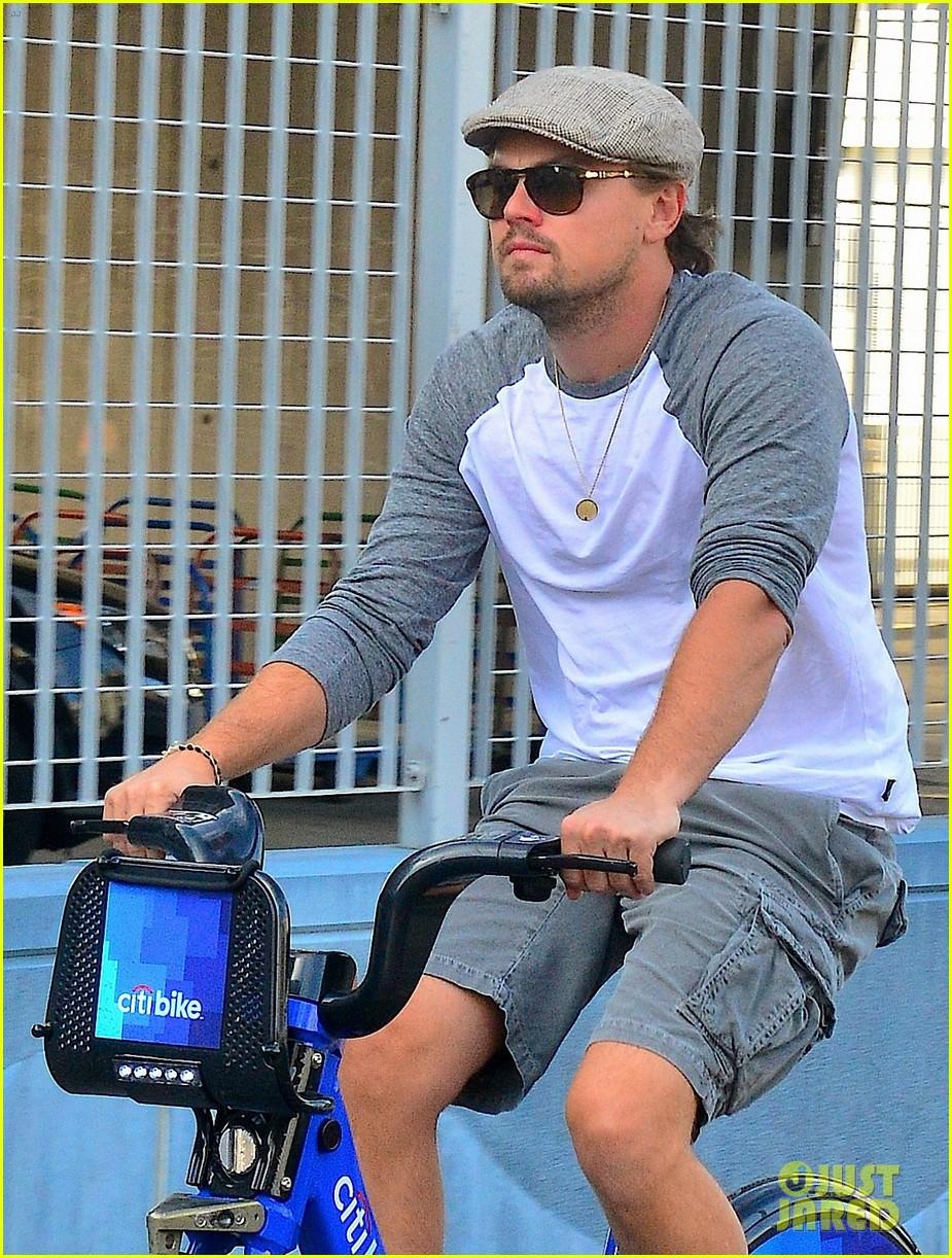 leonardo dicaprio rides a bike toni garrn parties for mademoiselle c 042946443