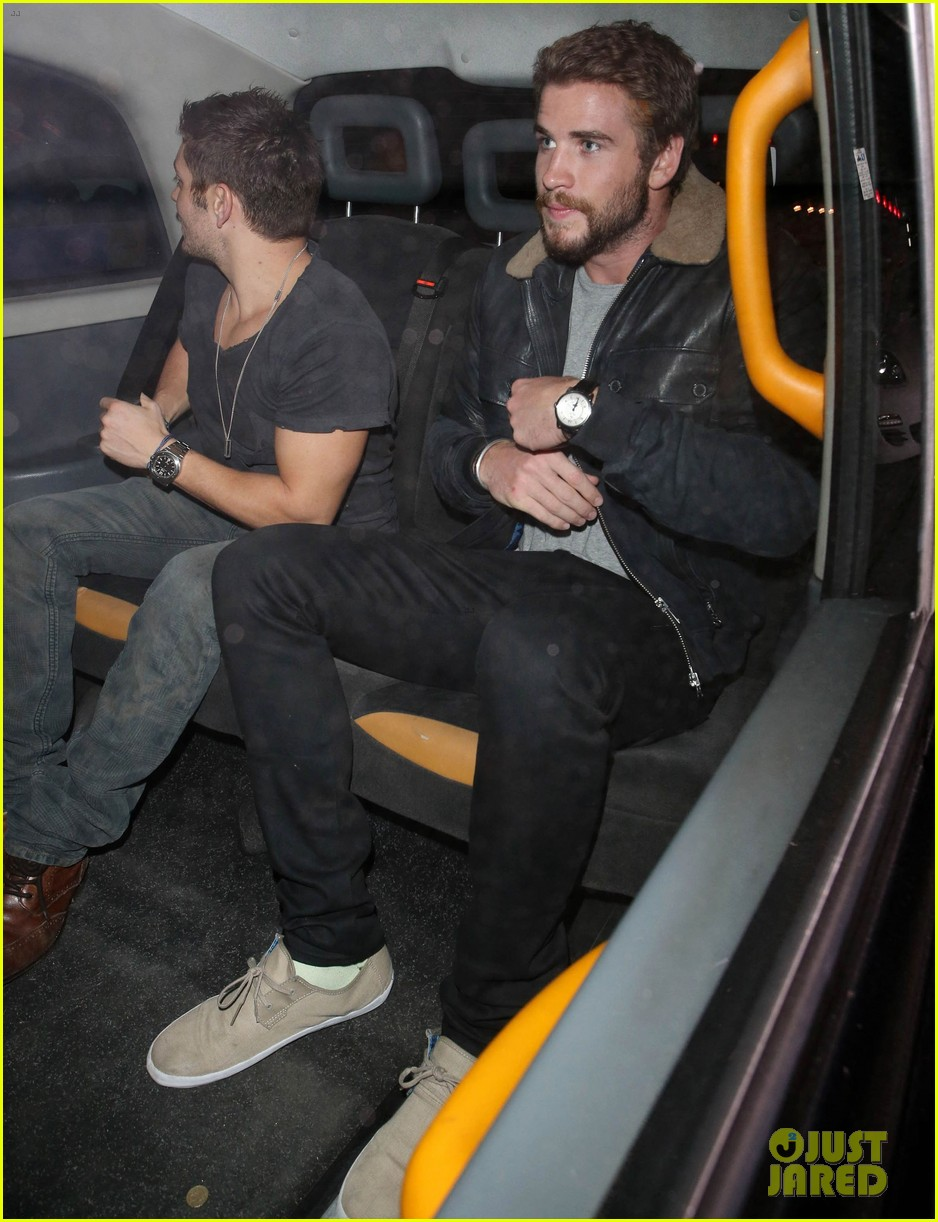 liam hemsworth reunites with brother chris in london 032941649