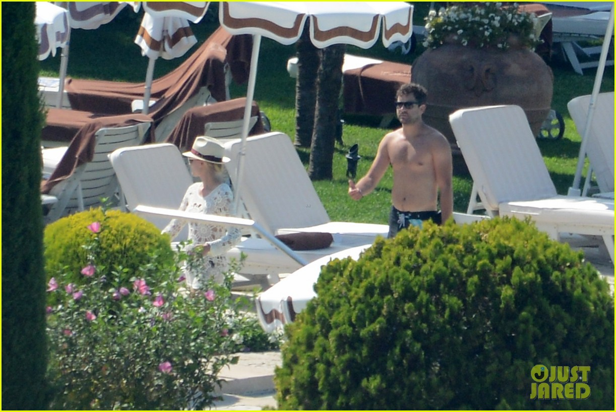 shirtless joshua jackson diane kruger lounge poolside before flights 232944584