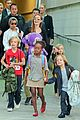 angelina jolie arrives in syd with all six kids 06