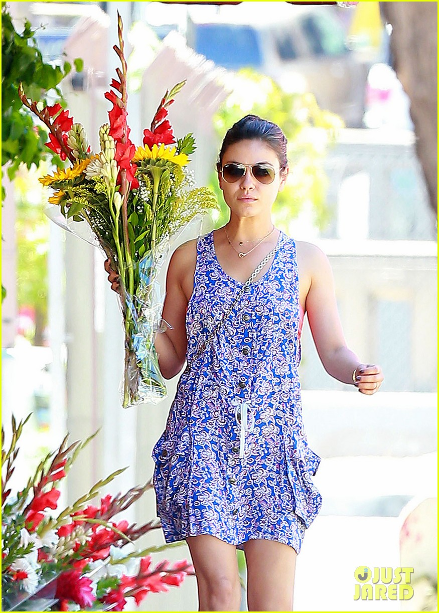 mila kunis bares hint of bra while running errands 02