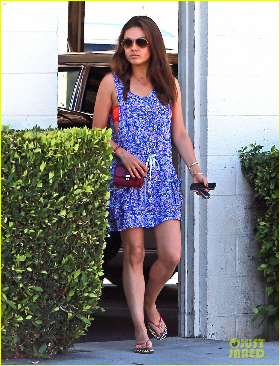 mila kunis bares hint of bra while running errands 03
