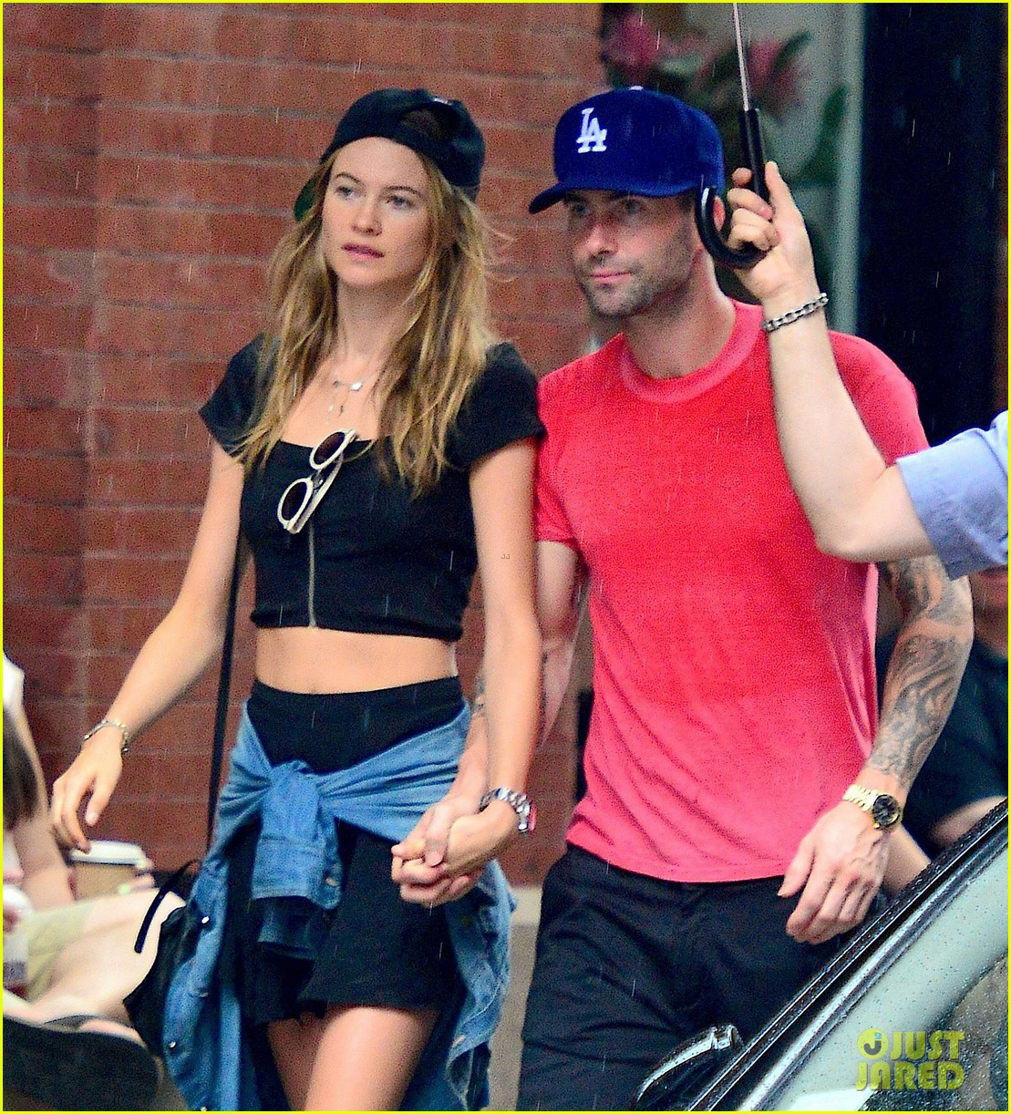 adam levine behati prinsloo hold hands on rainy day 112942520