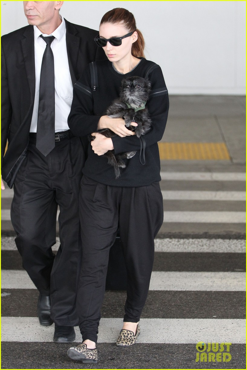 rooney mara holds pet pooch close at the airport 14