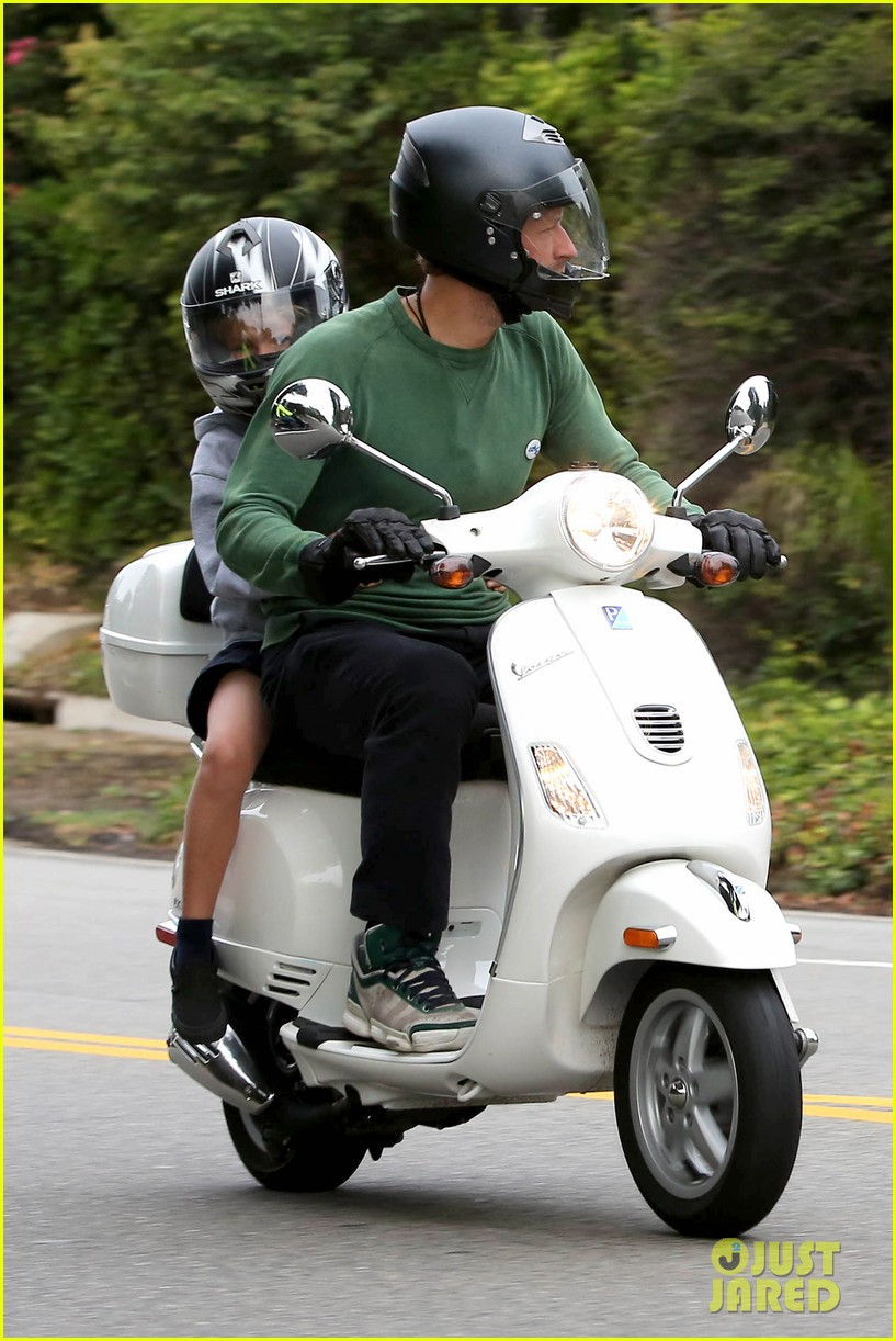 gwyneth paltrow chris martin side by side scooter rides 052950239
