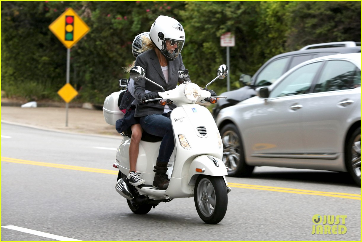 gwyneth paltrow chris martin side by side scooter rides 08