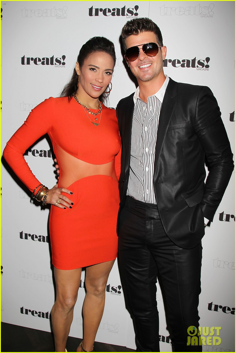 paula patton kisses robin thicke at his album release party 08