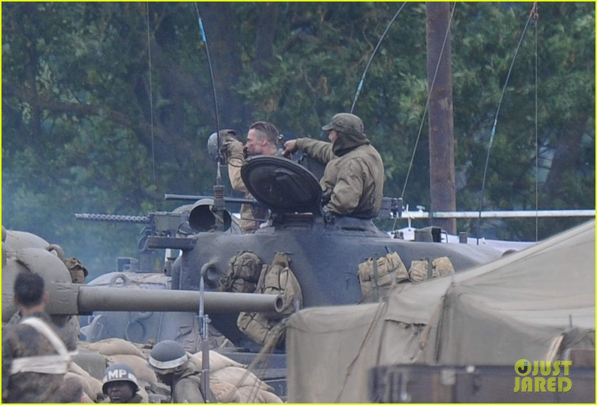 brad pitt rocks slicked back hair army outfit on fury set 17