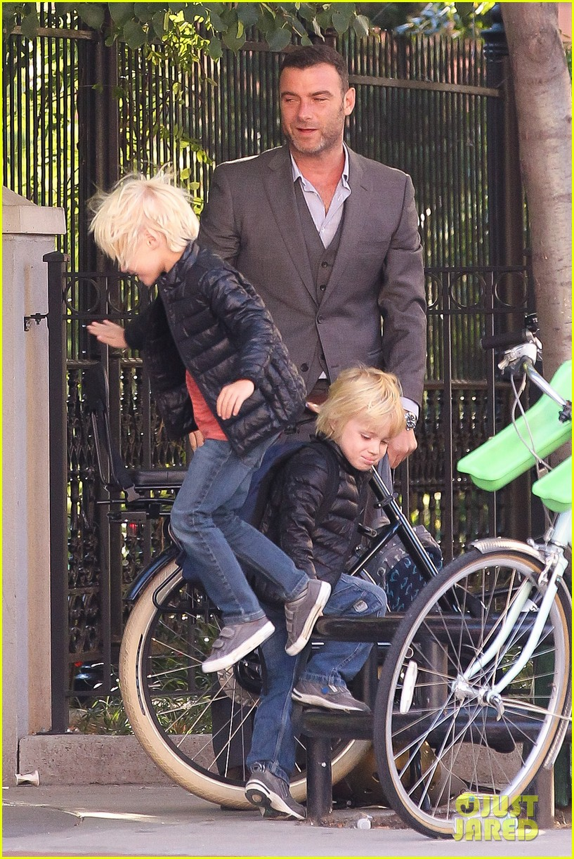 liev schreiber suits up for bike ride with his boys 182959093
